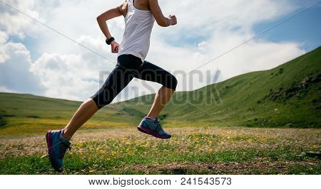 Young Fitness Woman Runner Running Grassland Trail