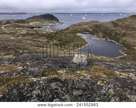 View Of Brimstone Head On Fogo Island, Newfoundland; Pond And Icebergs