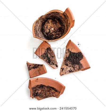 Broken Clay Flower Pot Isolated On A White Background. Damage Concept. Flat Lay