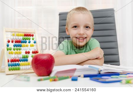 Preschooler, Student Doing Homework At The Desk At Home
