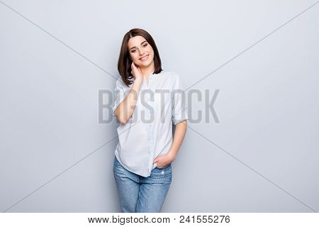 Portrait Of Trendy, Cheerful, Modern Girl In Denim Outfit, Holding Hands In Pocket Of Jeans And Touc
