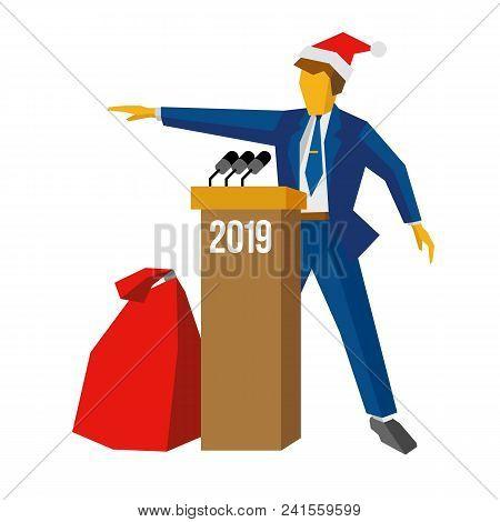 New Year 2018 Concept - Speaker At Podium In Santa Hat. Man Standing At Rostrum, Big Gift Bag Near.