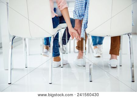 Portrait Of Romantic, Stylish, Cute, Lovely Couple Sitting On Chairs At The Table Having Meeting Wit