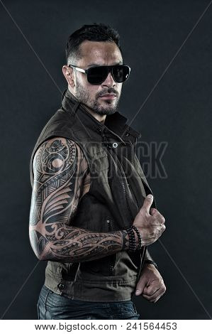 Tattoo Model With Beard On Unshaven Face. Bearded Man With Tattoo On Strong Arms. Tattooed Man With