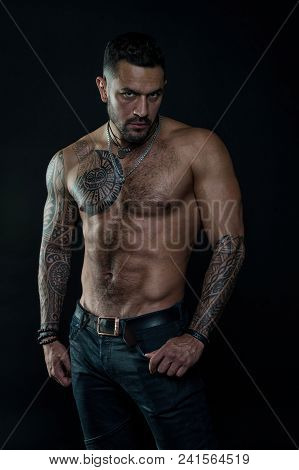 Sport Or Fitness And Bodycare. Bearded Man With Fit Tattooed Body. Man With Sexy Bare Torso In Jeans