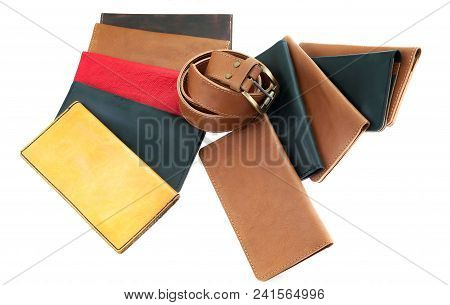 Multi-colored Leather Wallets And A Belt. Leather Accessories And Products Isolated On White Backgro
