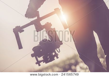Videographer With Professional Gimbal Video Camera Stabilizing Equipment.
