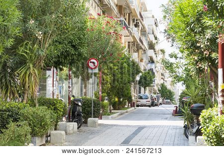 Street In Athens, Buildings, Parked Cars, Green Trees, Summer In A Residential Area Of The Capital O