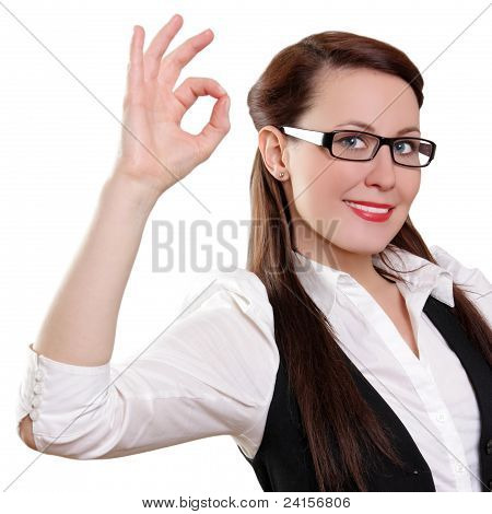 Businesswoman with okay gesture