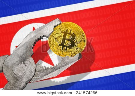 Bitcoin (btc) Coin In A Vice Under Pressure On North Korea (dprk) Flag Background. Prohibition Of Bi