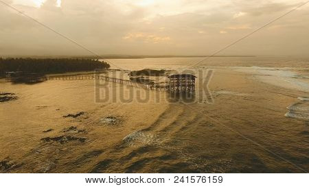 Viewpoint In The Ocean At Cloud Nine Surf Point At Sunset, Siargao Island , Philippines. Aerial View