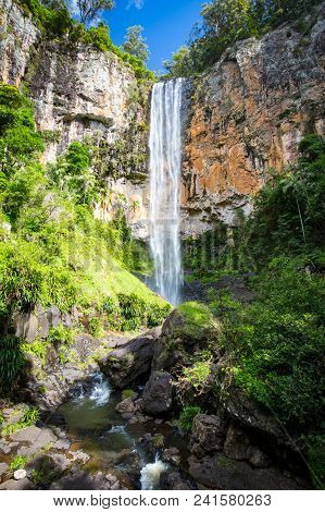 The Majestic And Iconic Purling Brook Falls On A Warm Autumn Day In Springbrook National Park Near T