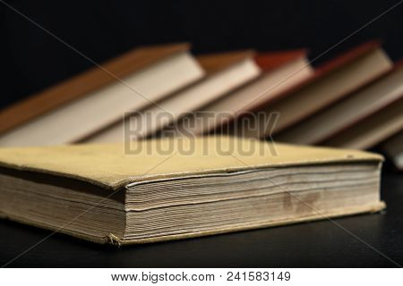 Old Book On Wooden Background. Back To School With Copy Space.