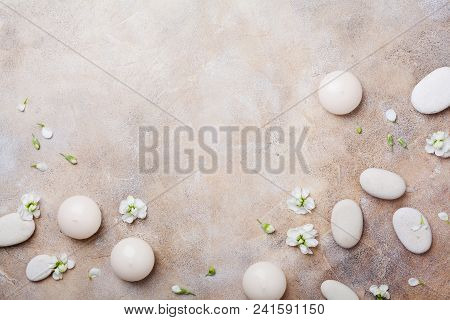 Aromatherapy, Beauty And Spa Background With Pebble And Candles Decorated White Flowers. Relaxation
