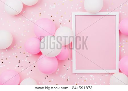 Birthday Mockup With Frame, Pastel Balloons And Confetti On Pink Table Top View. Flat Lay Compositio