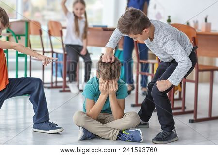 Children bullying their classmate in school