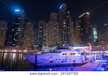 Dubai, United Arab Emirates - December 26, 2017: Yacht Club In Dubai Marina District At Night. Yacht