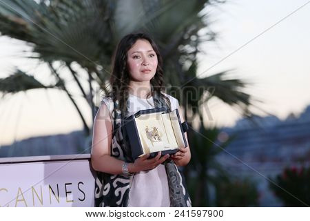 Actress Samal Yeslyamova attends the photocall the Palme D'Or Winner during the 71st Cannes Film Festival at Palais on May 19, 2018 in Cannes, France.
