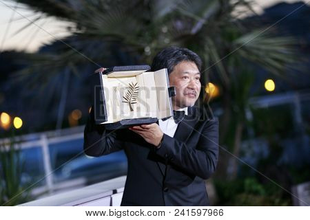 Japanese director Hirokazu Kore-eda attends the photocall the Palme D'Or Winner during the 71st Cannes Film Festival at Palais on May 19, 2018 in Cannes, France.