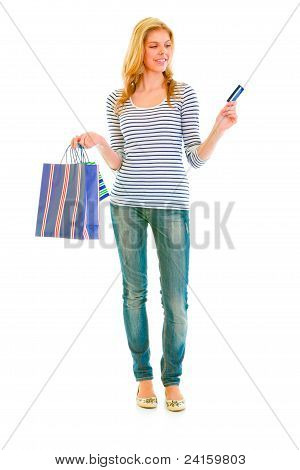 Full Length Portrait Of Attractive Teen Girl With Shopping Bags And Credit Card