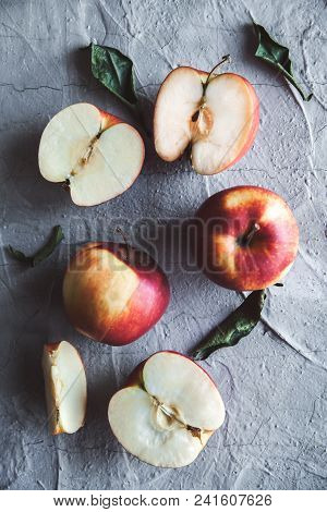 Green Apples, Whole And Sliced With Leaves. On A Rustic Stone Table. Top View A