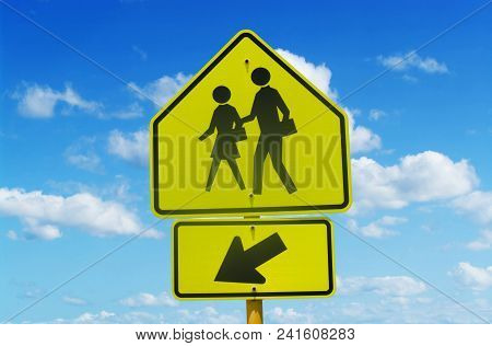 School Crossing Street Sign With Blue Sky And Clouds In Background Taken In Mid-afternoon.