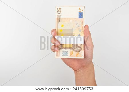 Stack Of Fifty Euro Bills Isolated On White Background.