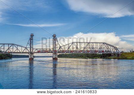Kuzminsky Bridge is a railroad drawbridge of a vertical-climbing type across the Neva River, Russia poster