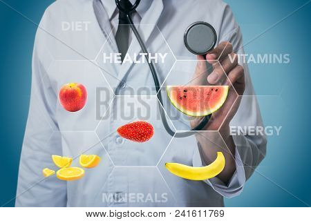 Doctor With Stethoscope And Fruits For Healthy Food On A Blue Background
