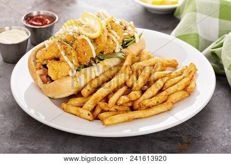Shrimp Po Boy Sandwich With Fries Served With Soda