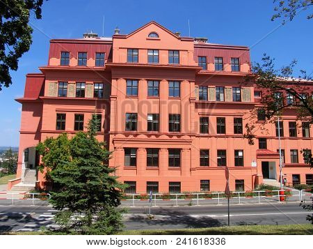 Old Red Building Of An Elementary School.