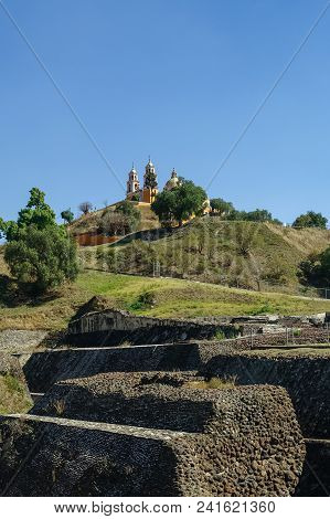 Ruins Of Cholula Pyramid With Church Of Our Lady Of Remedies At The Top Of It - Cholula, Puebla, Mex