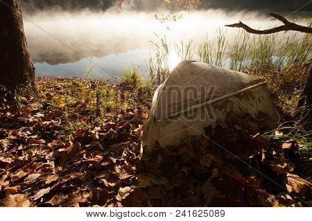 A Boat On The Edge Of A Foggy Lake At Dawn.  Hocking Hills State Park, Oh, Usa.