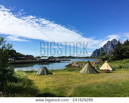 Beautiful Camping Site By The Lake With Mountains In A Distance, Norway