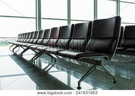 Empty Departure Lounge With Chairs At The Airport Before Flight