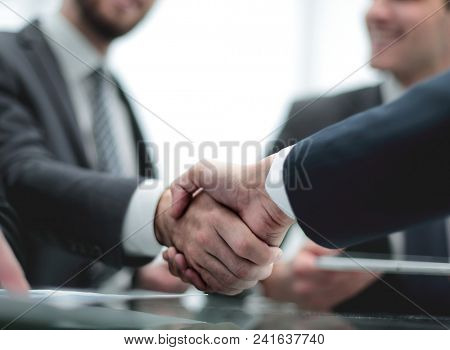 Close-up image of a firm handshake