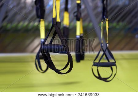 Close-up Image Of A Trx Suspension In Closeup Inside Of A Gym.