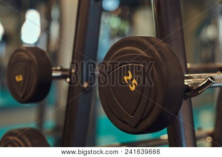 Weight Training Equipment In A Modern Gym Indoors. Close-up Image Of Dumbells On A Stand. Gym Equipm