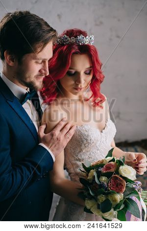 Portrait Of Young Happy Newlyweds In A Loft Style Room, Close-up