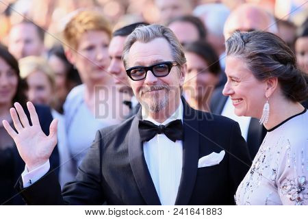 Gary Oldman and Gisele Schmidt attend the Closing Ceremony during the 71st  Cannes Film Festival at Palais des Festivals on May 19, 2018 in Cannes, France.
