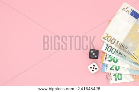 Casino, Gambling And Fortune Concept - Close Up Of Black And White Dice And Euro Money On Pink Backg