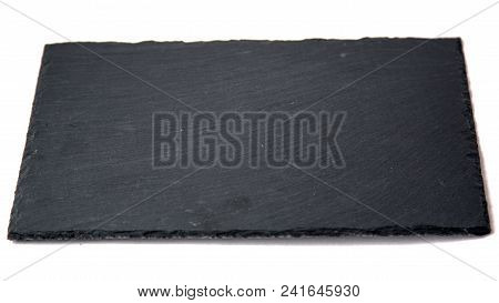 Dark Grey Black Slate Board For Dishes On White Background With Copy Space Natural Light Selective F