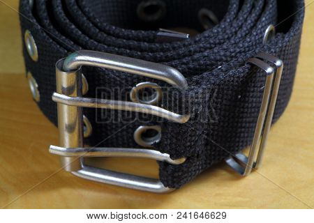 Close-up Of A Black Fabric Belt Wind Up