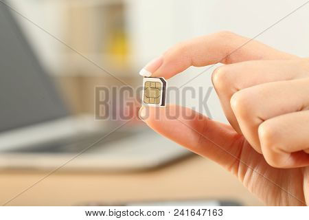 Close Up Of A Hand Holding A Sim Card At Home