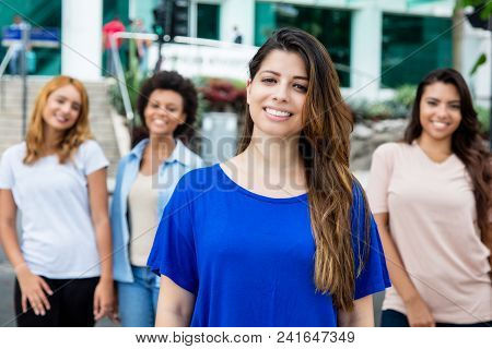 Hispanic Woman With Latin And Hispanic And African Girls Outdoor In The City