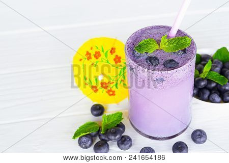 Blueberry smoothies juice,beverage healthy the taste yummy In glass drink episode morning on white wood. poster