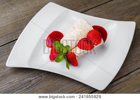 Sweets, Confectionery,  Unhealthy Food, Sugar, Calories. Ice Cream With Strawberry Syrup Close Up