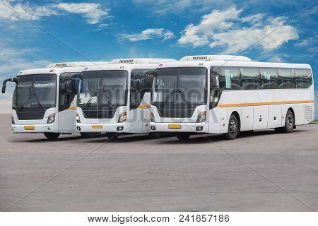 Big White Tourist Buses On Parking Photo
