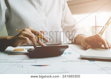 Close Up A Man Working About Financial With Calculator At His Office To Calculate Expenses, Accounti