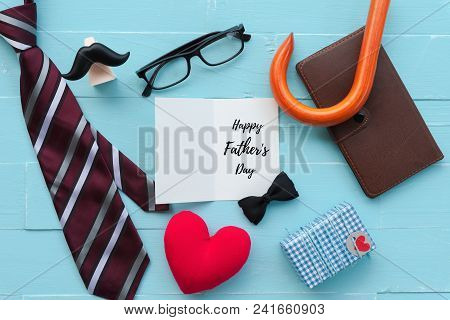 Happy Fathers Day Concept. Red Tie, Glasses, Mustache, Notebook, Gift Box With Happy Father's Day Te